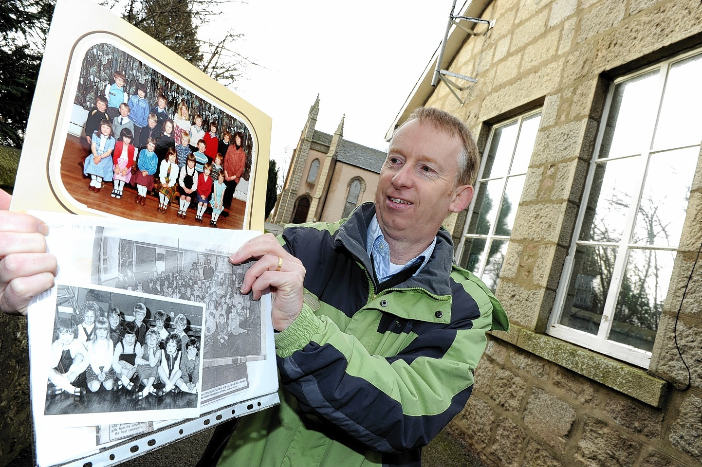 Drum Primary head teacher, Paul Wilson, at the school with some photographs