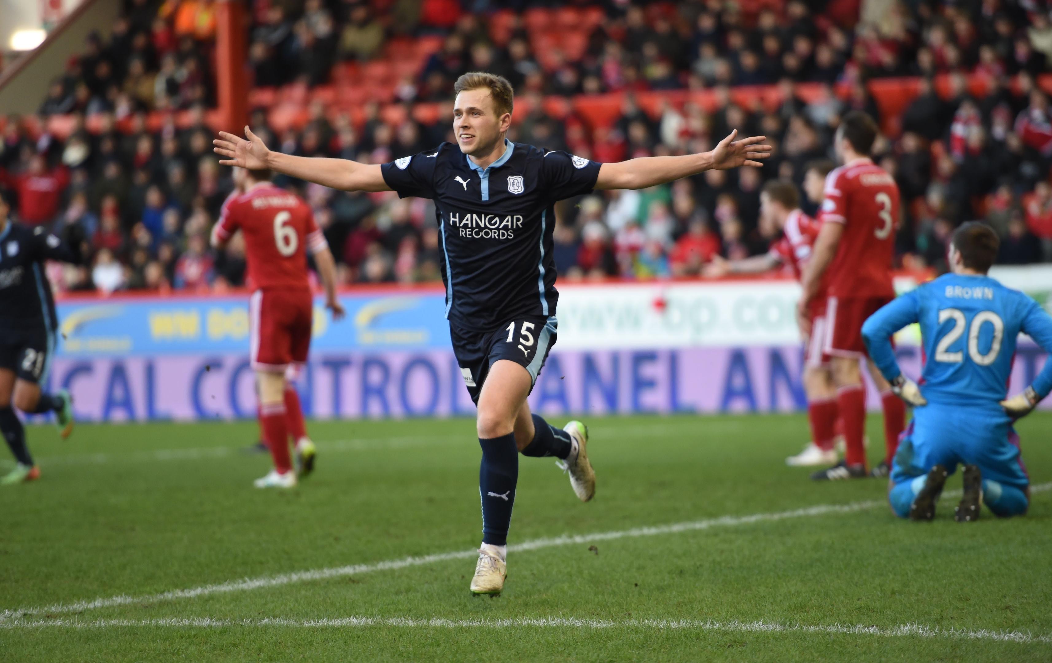 Greg Stewart celebrates netting for Dundee