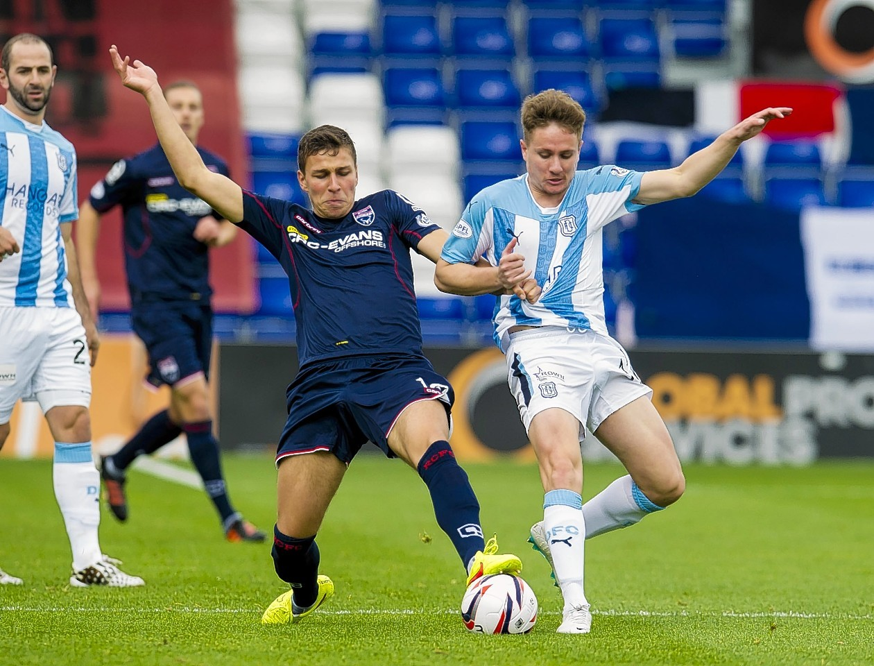 Kiss challenges Dundee's Simon Ferry earlier this season.