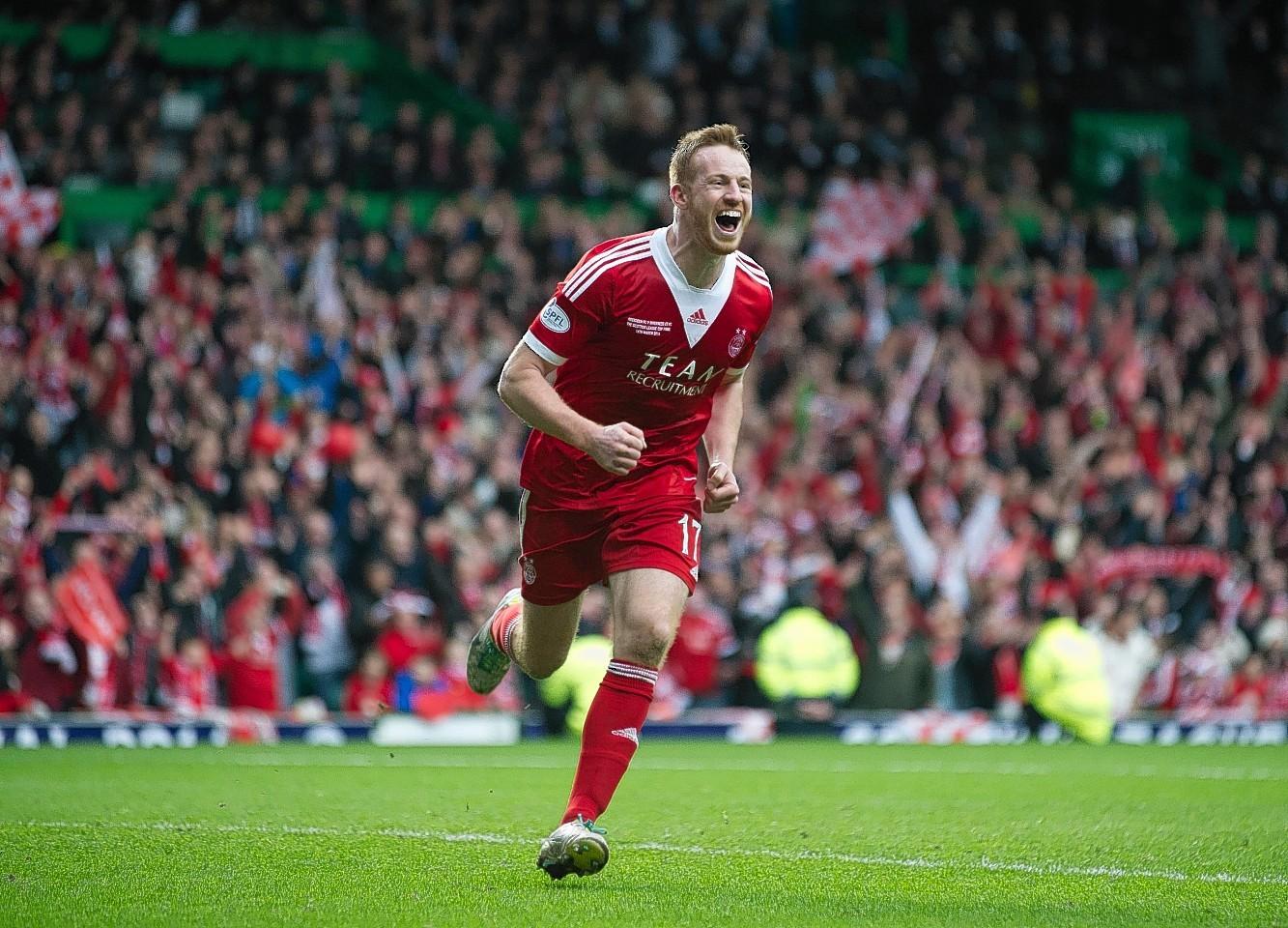Rooney celebrates netting the winning penalty in last season's final