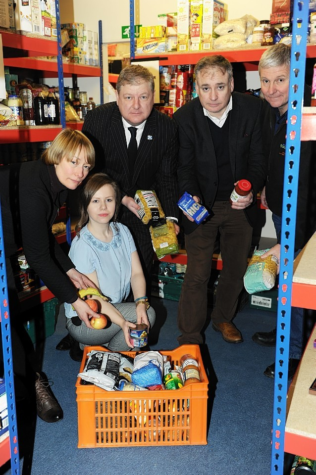 L-R: Jo Roberts, Development Manager for Community Food Moray, Jo-Ann De-Sykes, Research Admin Assistant, Moray MP, Angus Robertson, MSP, Richard Lochhead, and Andy Walker, Moray Foodbank Coordinator, at the Moray Foodbank in High Street, Elgin