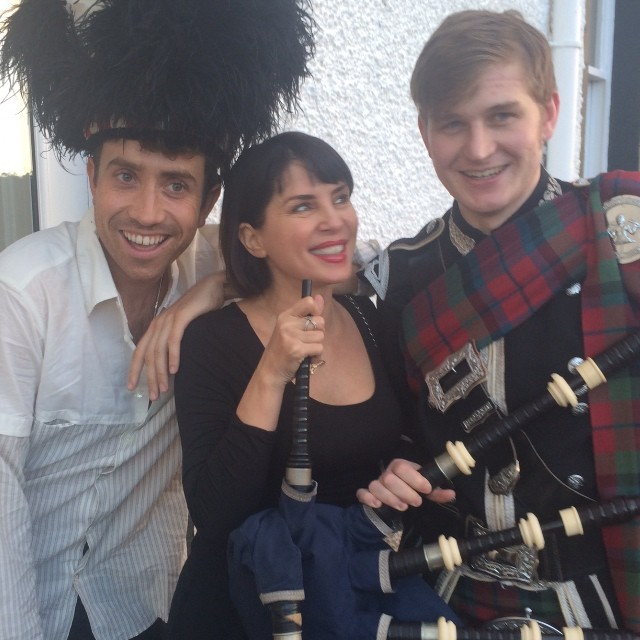 Nick Grimshaw and Sadie Frost celebrate with a piper at Craigellachie Hotel