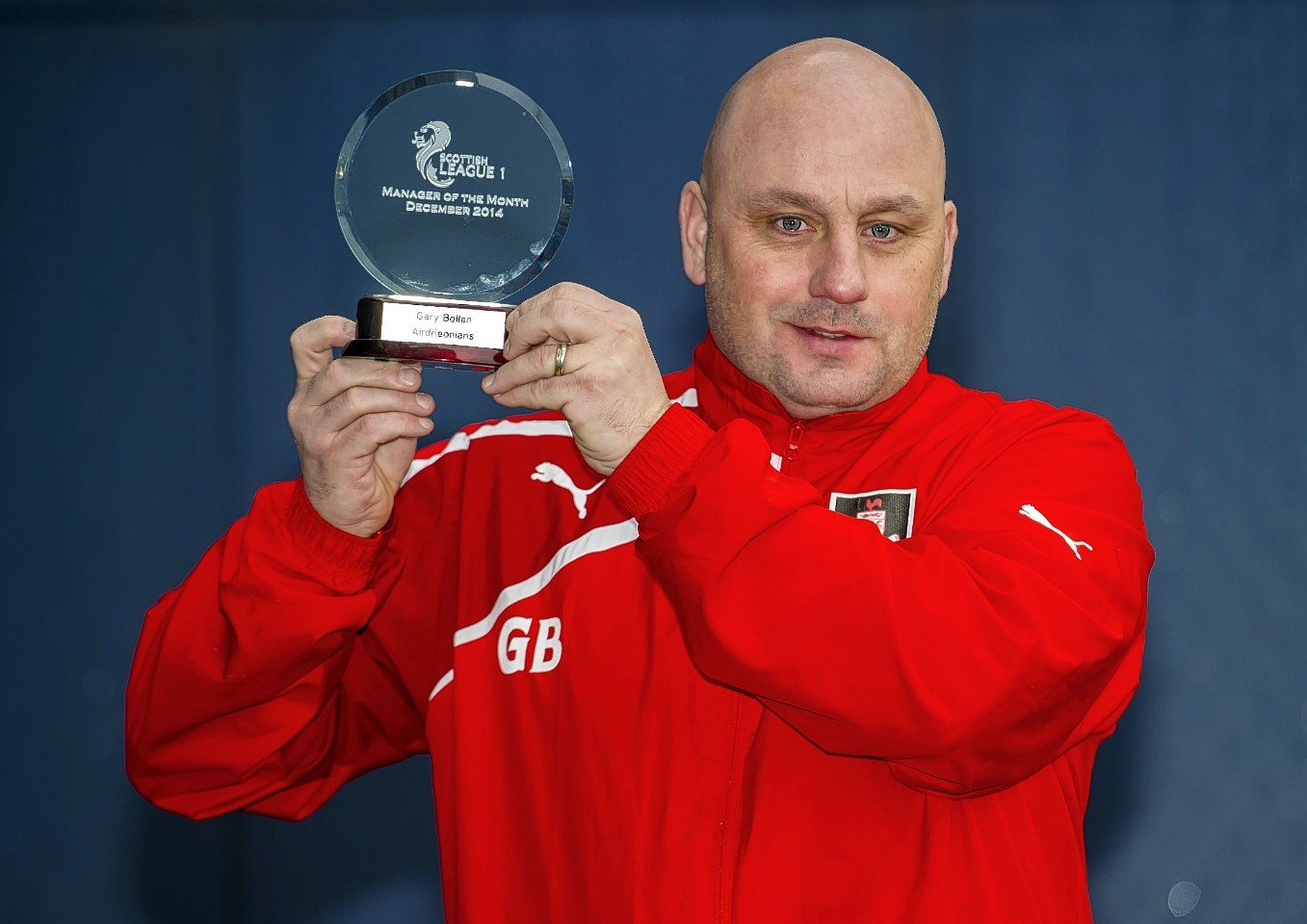Gary Bollan collects his manager of the month award