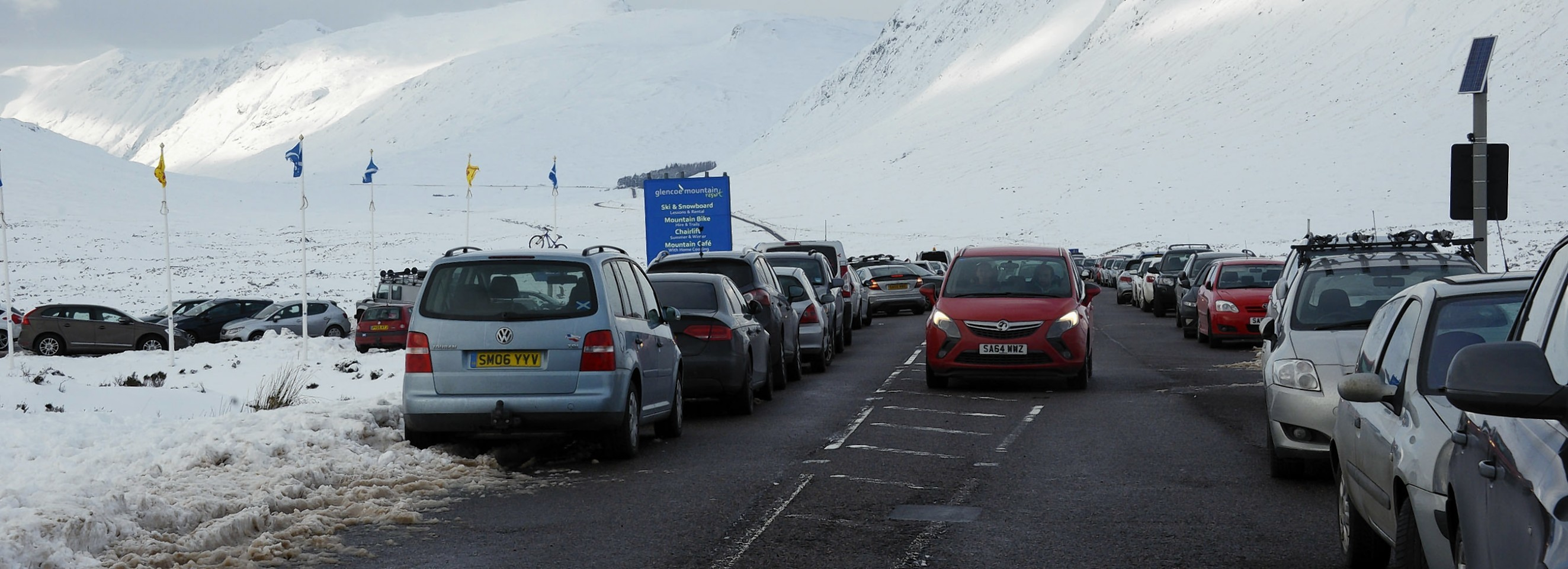 Cars line the busy A82 at Glencoe Mountain Resort yesterday