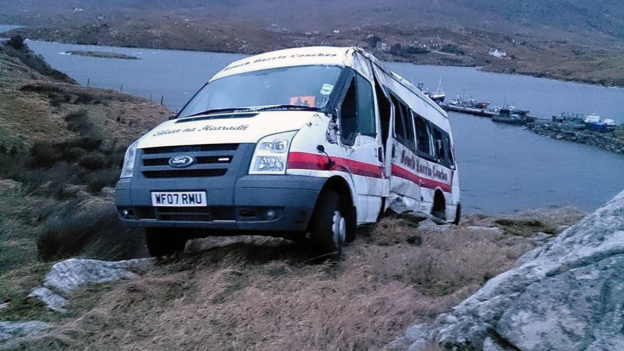 The 16-seater minibus hanging over the edge of the cliff on Isle of Scalpay