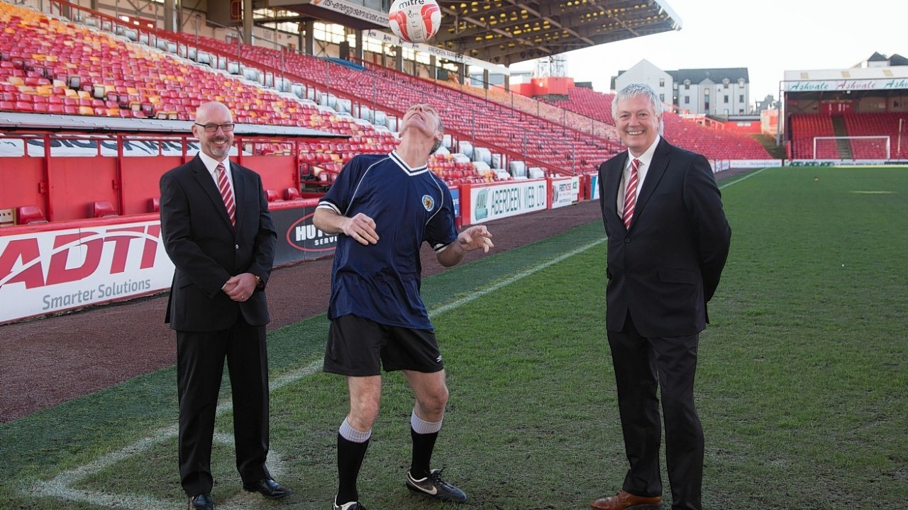 Jim Murphy shows off his football skills