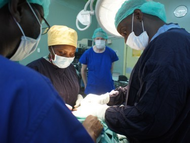 Dr John Sekabira carrying out an operation under the watchful eye of ARCHIE chief executive, David Cunningham