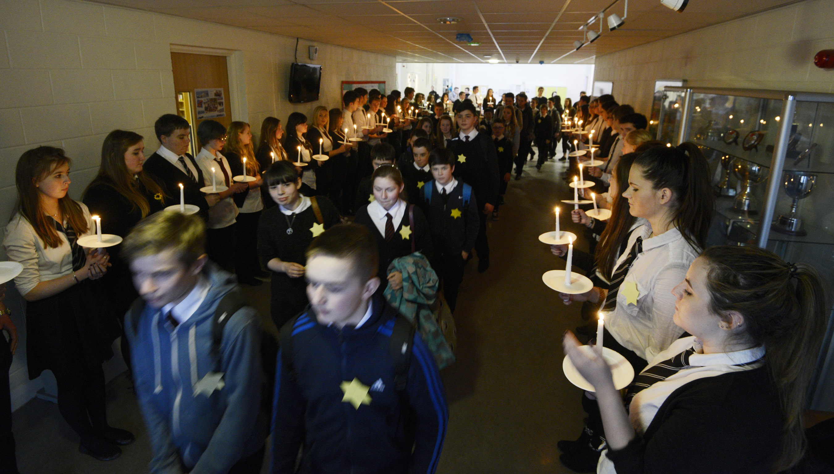 Lochaber High School pupils left the school in silence passing between sixth form students holding candles to mark the liberation of Auschwitz 70 years ago