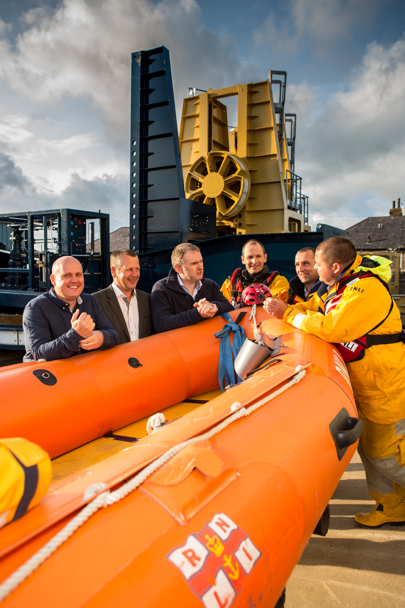 Mike Gaskin, commercial director at Maritime Developments, George Mackintosh, production director at Maritime Developments, and Derek Smith, chief executive of Maritime Developments, with Andrew Simpson, flood response team member and DLA, David Weir, crew member at RNLI Peterhead, and Alastair Wilson, full-time mechanic and crew member at RNLI Peterhead.