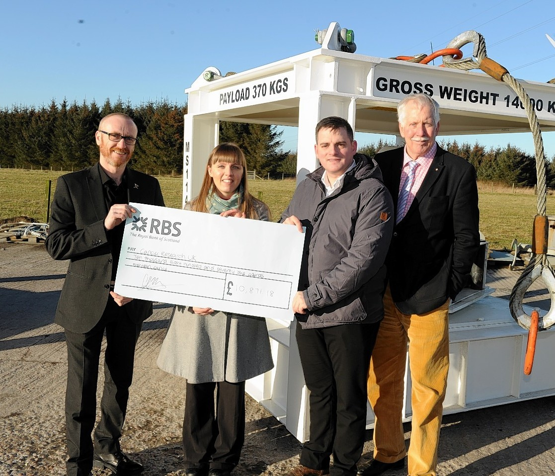 Motive Offshore Services Ltd at Boyndie, Banff handed over money to two charities - ARCHIE  and Cancer Research UK