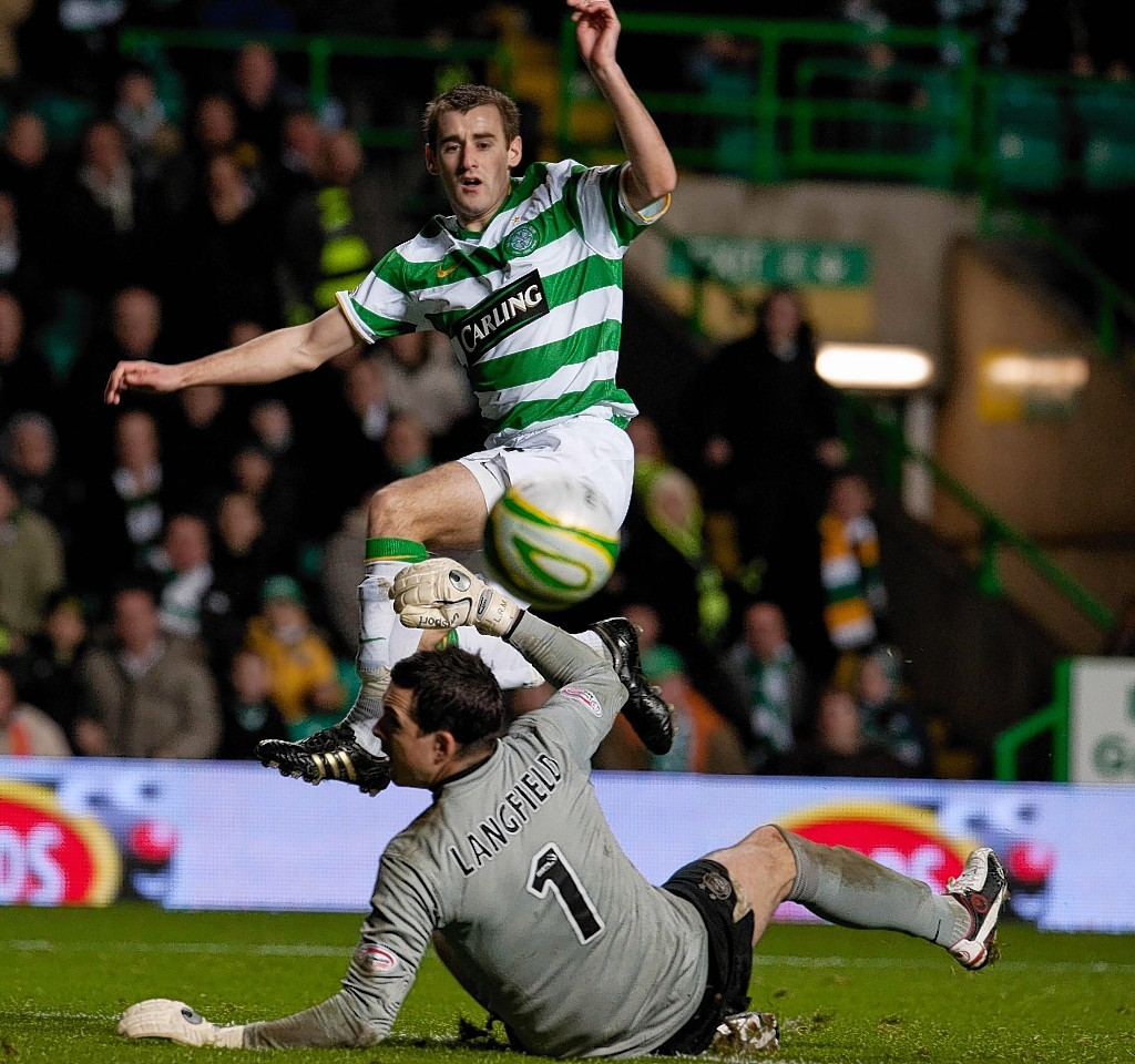 Niall McGinn chips Jamie Langfield while playing for Celtic