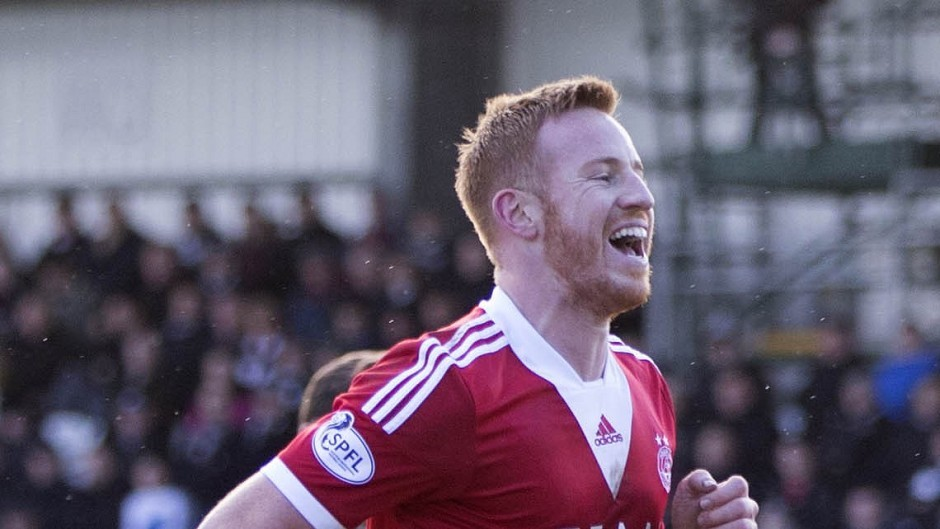 Aberdeen's Adam Rooney is not distracted by league tables
