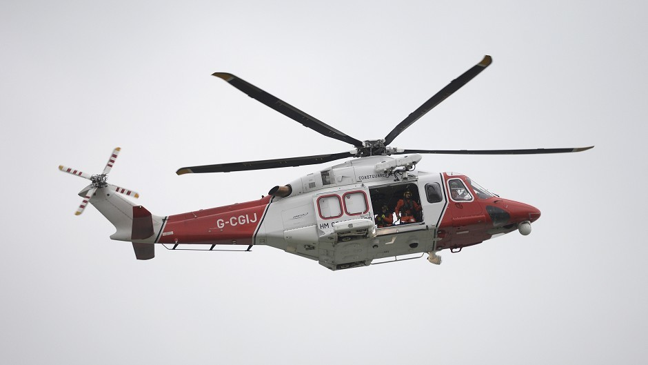 A Coastguard helicopter helped recover the fishermen