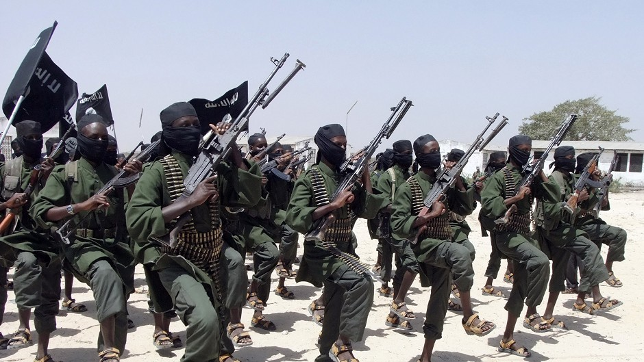 Al-Shabab fighters perform military exercises in the Lafofe area of Somalia. (AP)