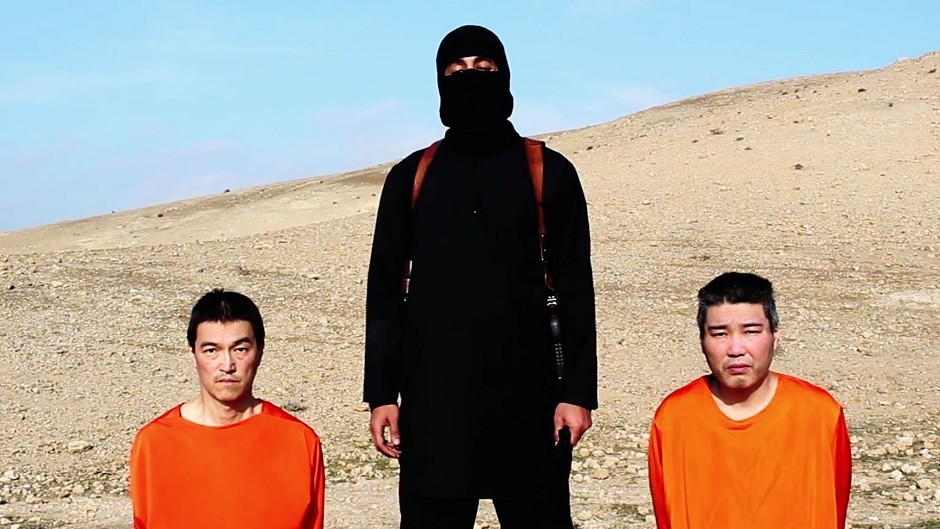 """This image taken from Islamic State video claims to show a militant who looks and sounds similar to the infamous """"Jihadi John"""" threatening to kill two hostages."""