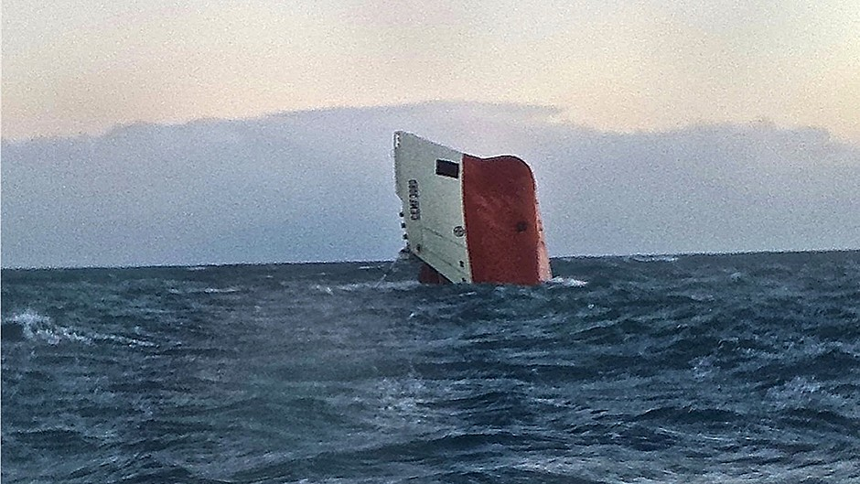 The Cemfjord cargo ship after it overturned off the north coast of Scotland (RNLI/PA)