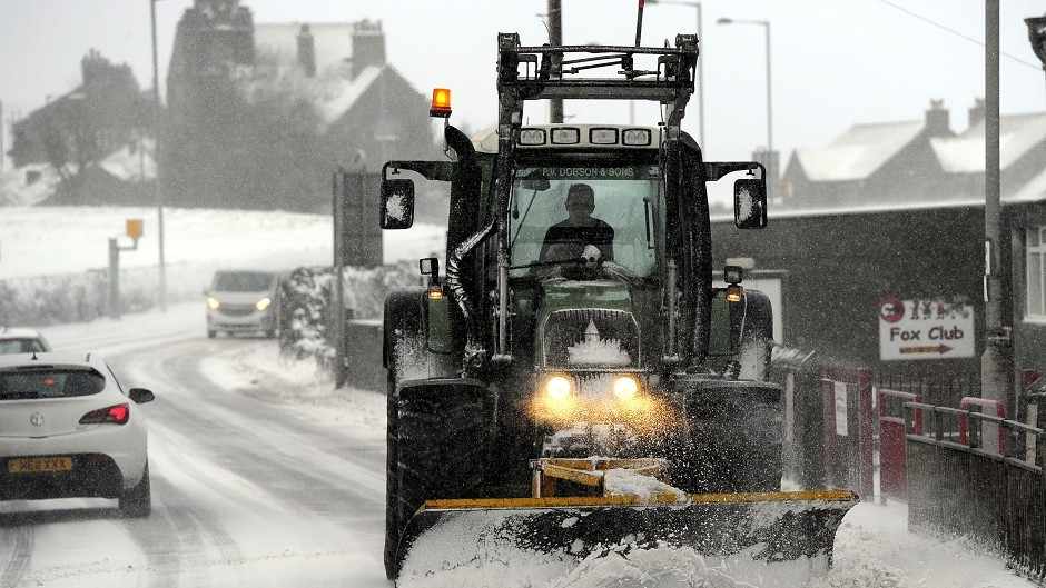 A snowplough clears the road