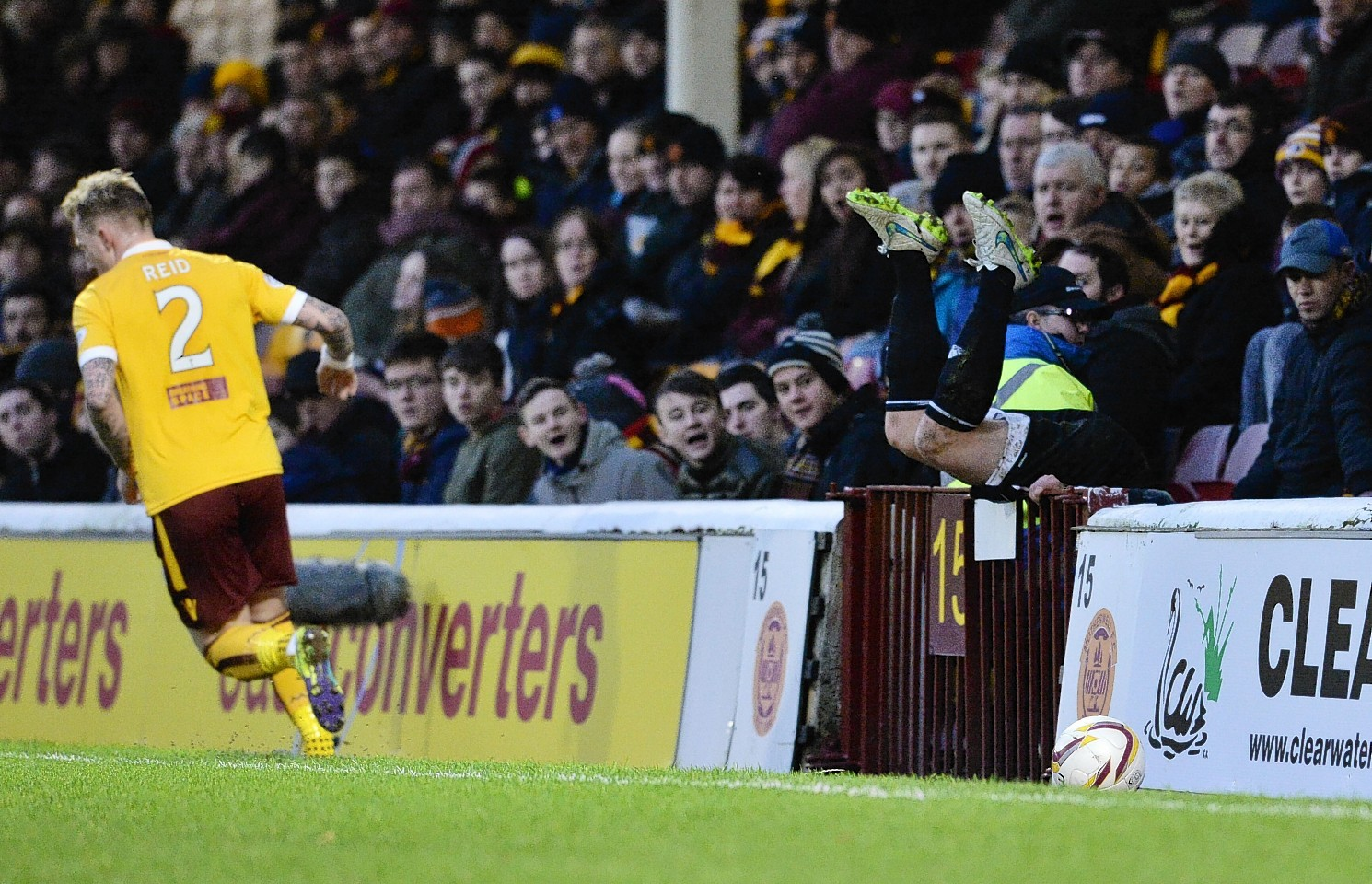 Peter Pawlett tumbles into the supporters at Fir Park.