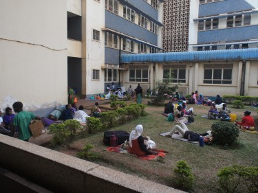 People camping out in the hospital's  courtyard