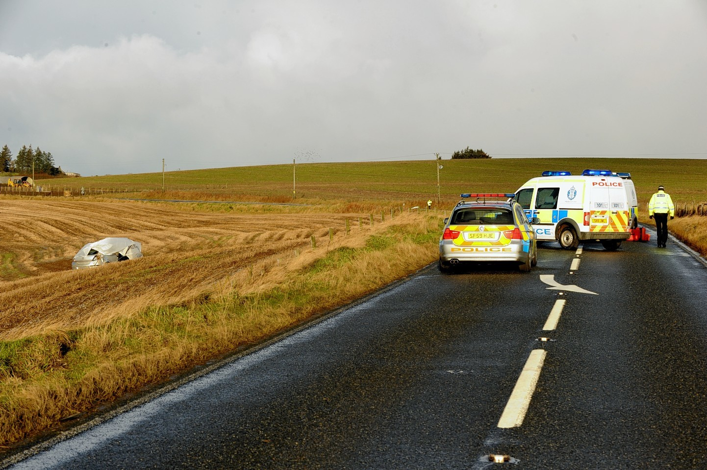 The road was closed after the death of a 23-year-old man