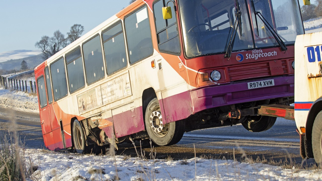 Stagecoach bus is lifted for removal from the site