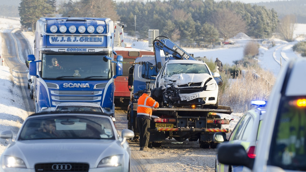 Vehicles file carefully past the totalled 2010 Skoda Octavia