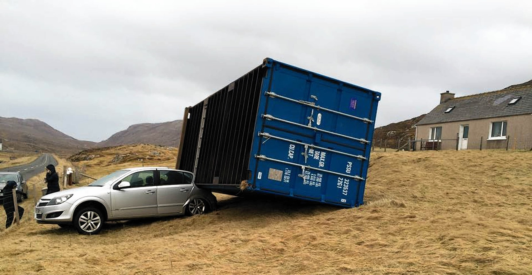 A shipping container weighing two-and-a-half tonnes crushed a car as it was blown 80ft by hurricane-force winds.