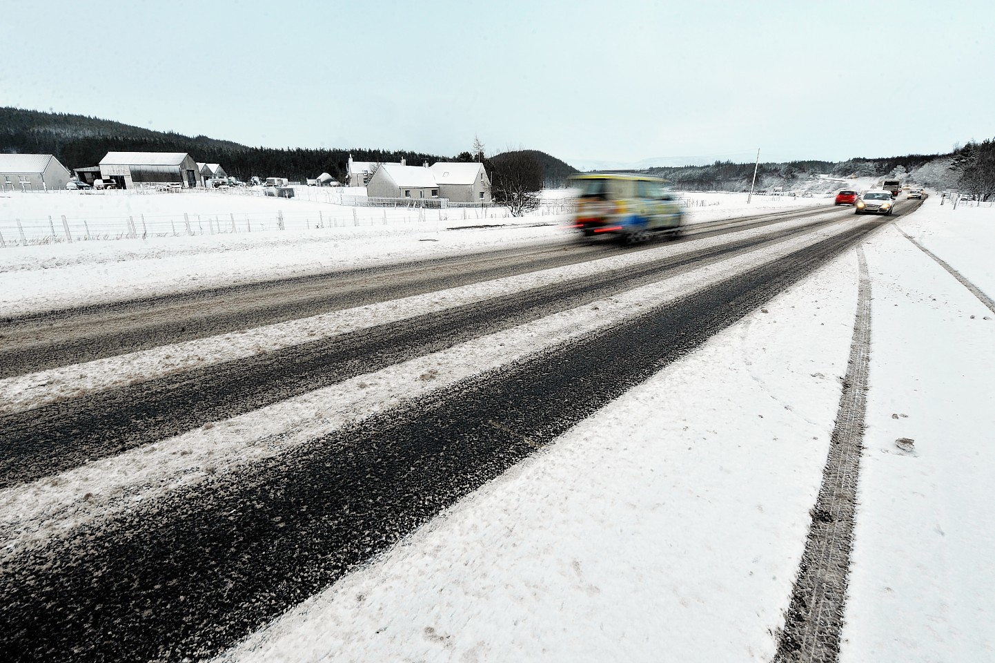 Snow lines the roads