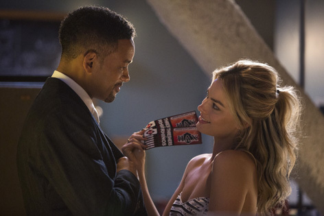 Will Smith as Nicky Spurgeon and Margot Robbie as Jess Barrett in Focus