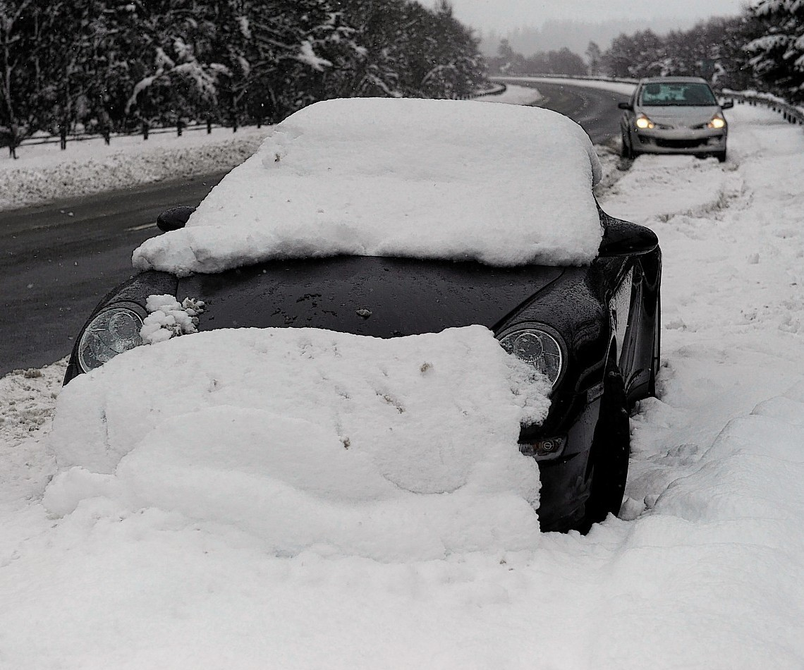 The Porsche was left at the Drumochter Pass... and has since been covered in snow