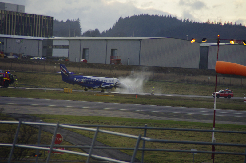 A picture of the plane with vapour rising from the side at Aberdeen International Airport. Credit: Charles Ioannou