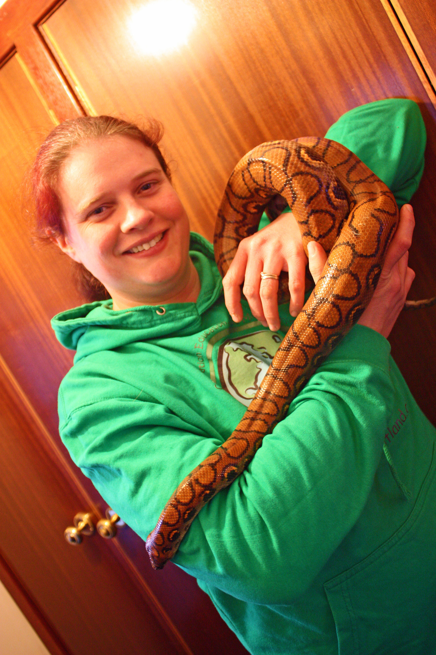 Becky Rowe with Epi the Brazilian Rainbow Boa