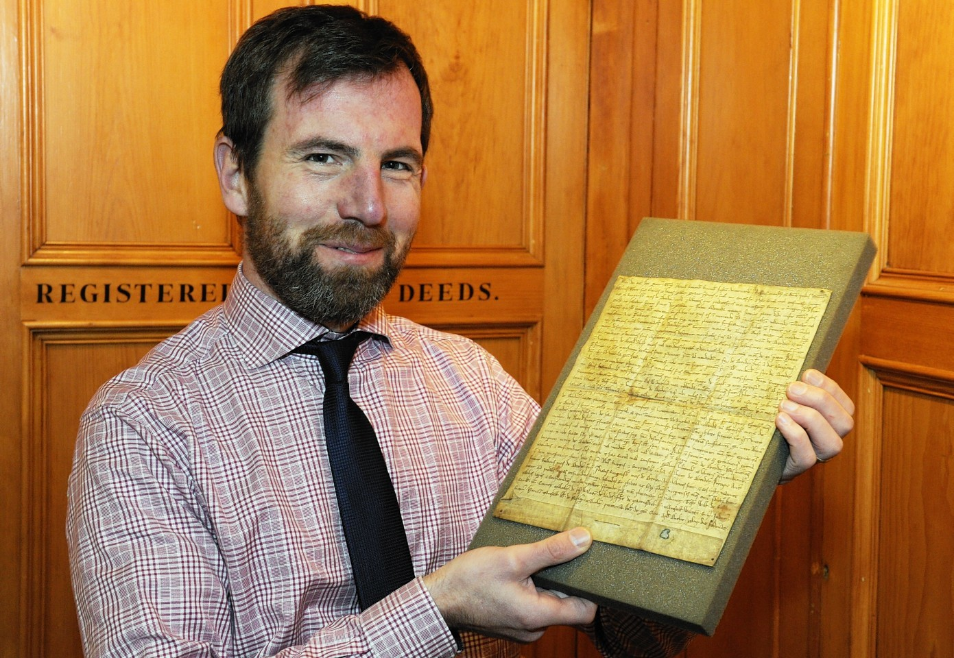 Phil Astley with the Charter from 1214 which details the rights given to Burgesses.