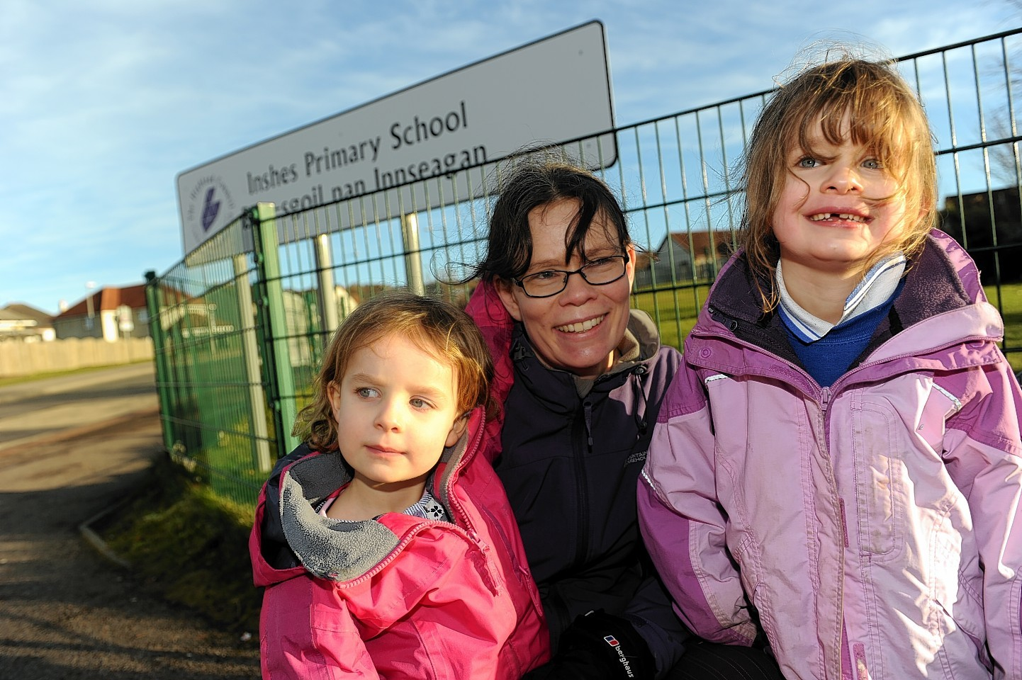um, Carolyn Cload, centre, with daughters, Hazel and Erica, who are respectively in Nursery and P2 at Inshes Primary School, Inverness.