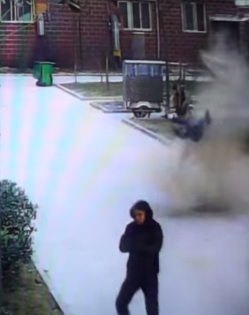 The young boy was thrown into the air by the explosion