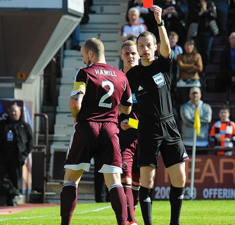 Collum loves that red card of his... here he sends off Jamie Hamill