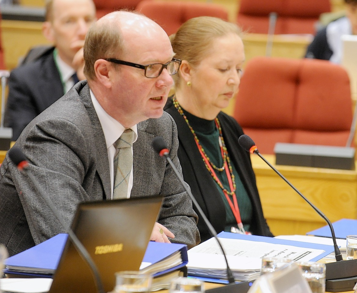 NHS Highland chairman Garry Coutts speaks to the Public Audit Committee, while Chief Executive Elaine Mead looks on