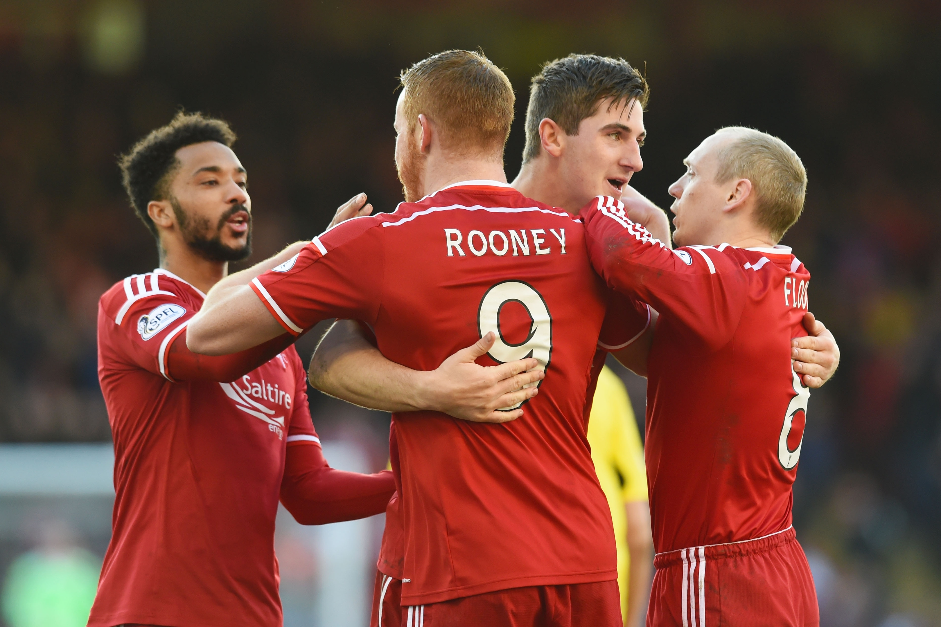 Aberdeen celebrate Rooney's second goal of the afternoon