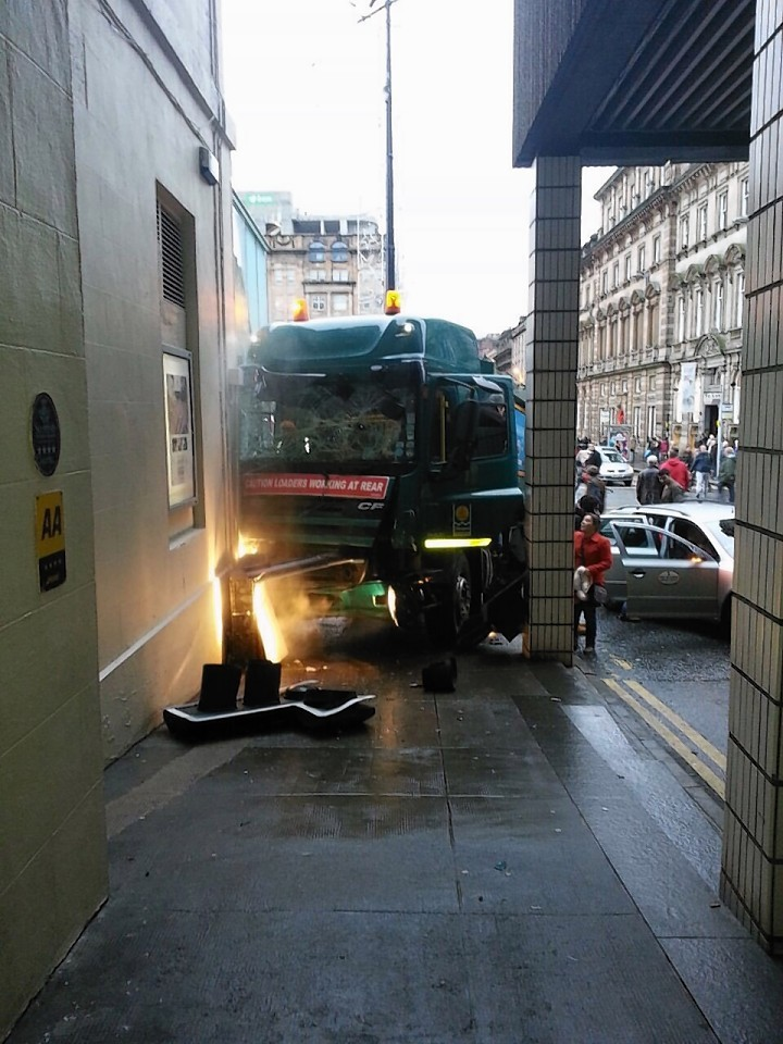 Possibly the first photo taken after the Glasgow bin lorry crash shows the driver slumped over the wheel. Photo courtesy of the Sunday Post