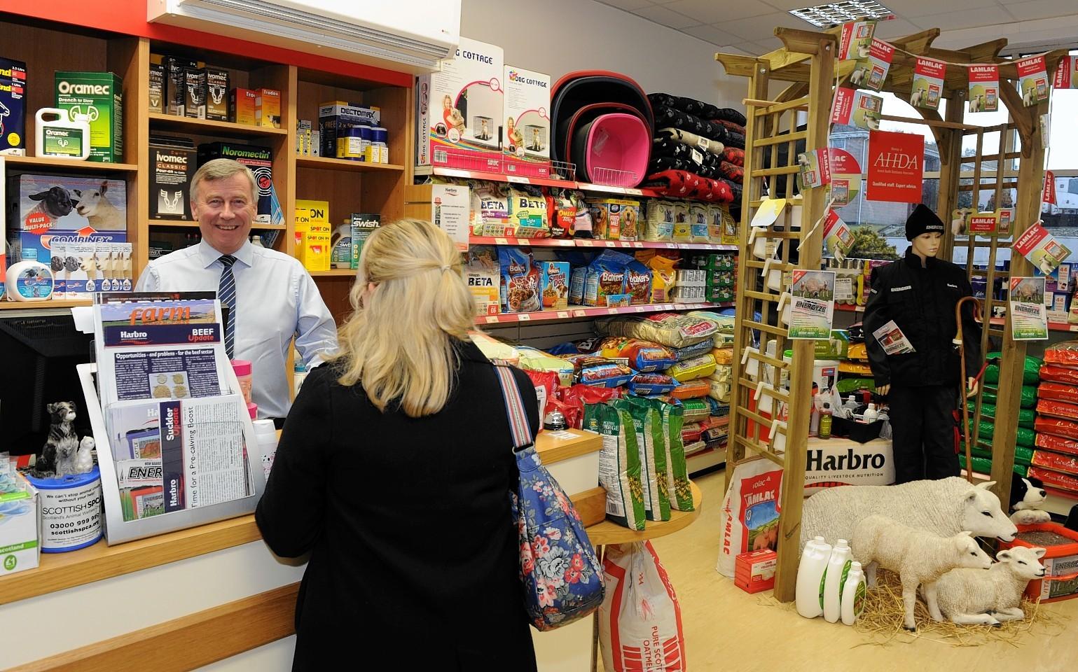 Graham Baxter serves a customer
