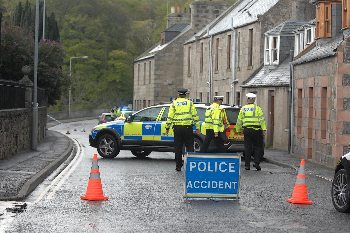 Police at the scene of the crash on Bogie Street, Huntly