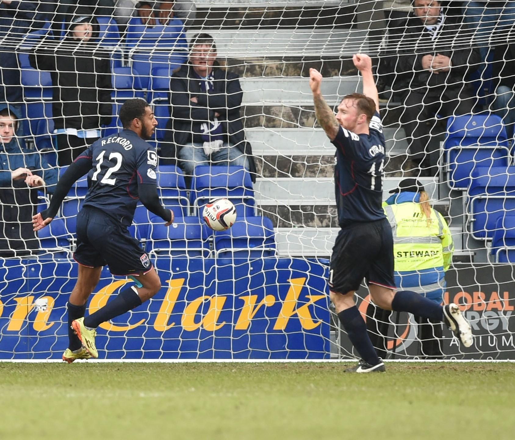 Jamie Reckord celebrates scoring for Ross County