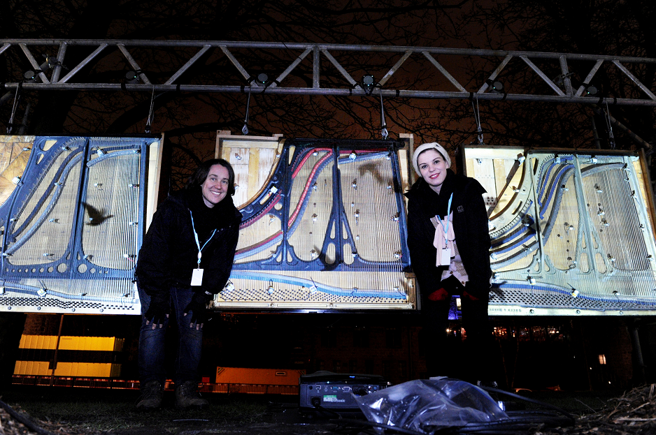 One of the artworks, ''Piano Migration Trio''  with artist Kathy Hinde (left) and Heidrun Kelly, Marketing director.