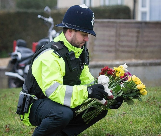 This police officer was amongst the residents to pay their respects