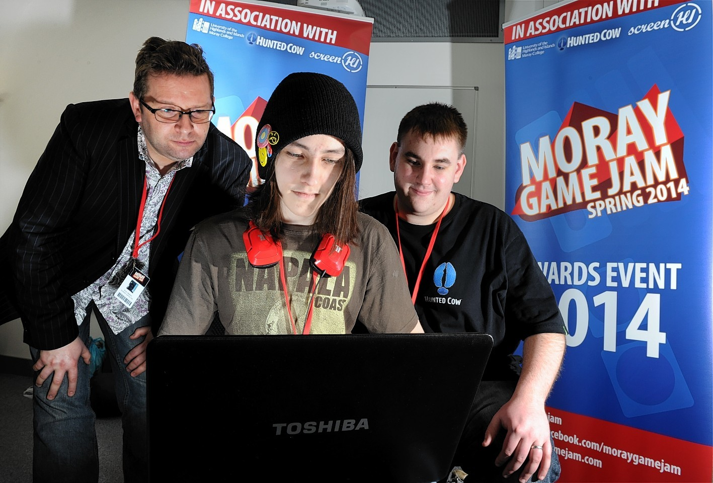Chris Day, HND Interactive Media student, with judges (left) Brian Baglow, Director of Scottish Games Network and Andrew Mulholland, Director of Hunted Cow Studios, at Moray Game Jam 2014