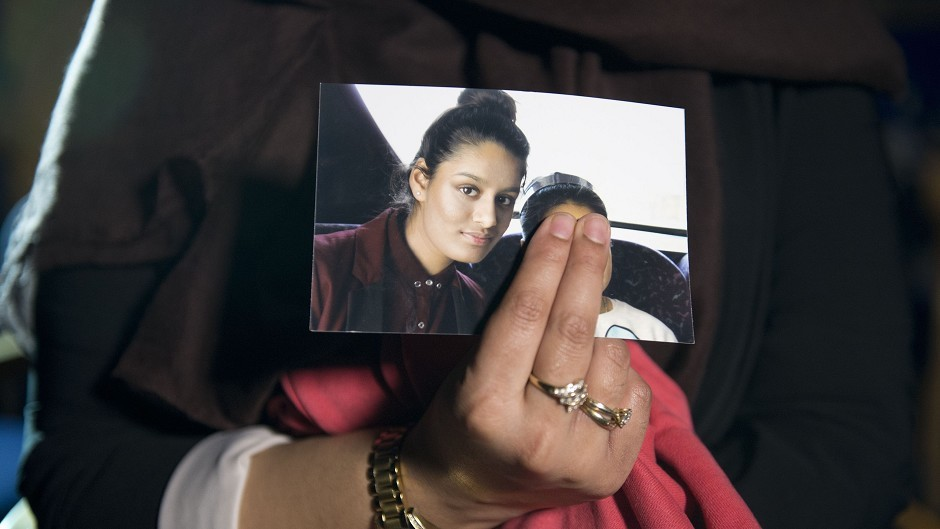 Renu Begum holds a photograph of her younger sister Shamima,