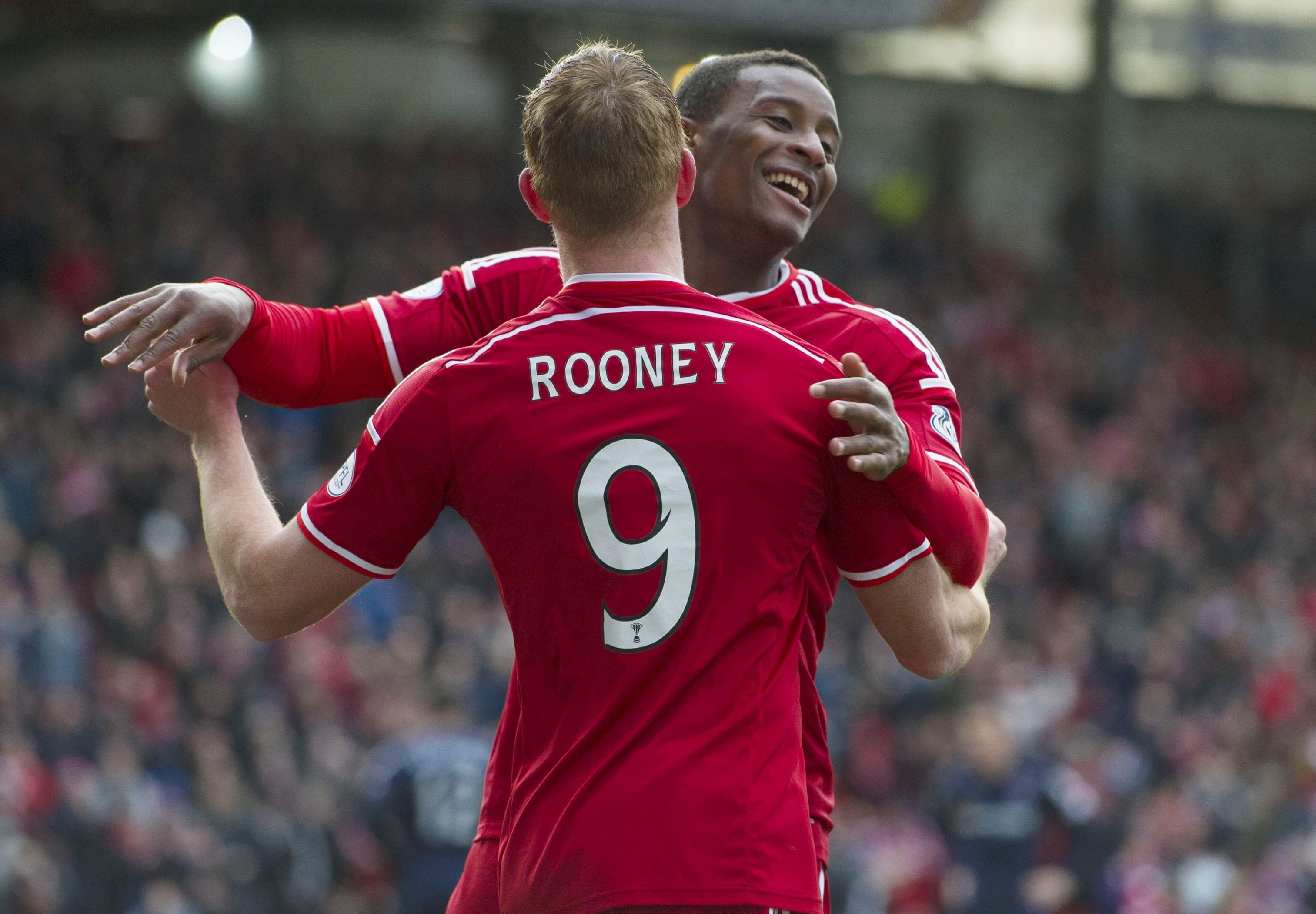Rooney and Daniels celebrate Aberdeen's opening goal