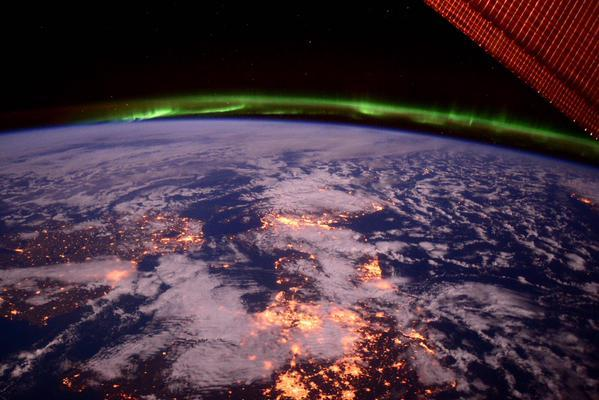 The aurora shielding the earth, as pictured from the ISS