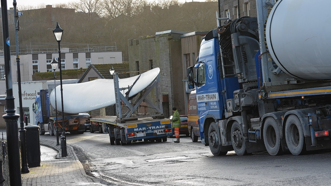 The turbine being transported through Wick town centre