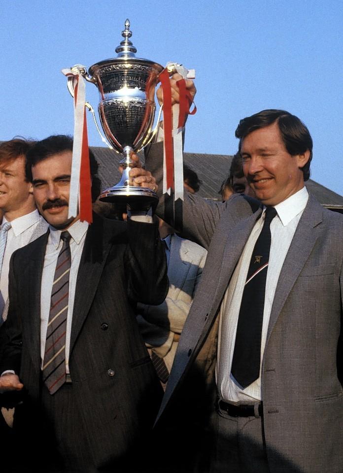Then Aberdeen boss Sir Alex Ferguson proudly shows off the Premier League title with captain Willie Miller
